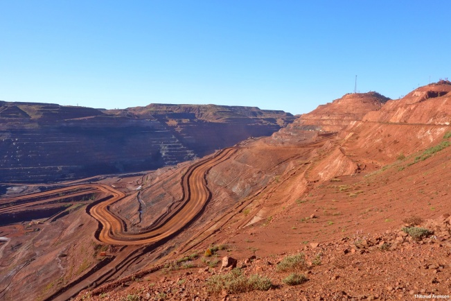 The Mt Whaleback mine has been producing iron ore for nearly fifty years. The pit is half a kilometer deep and 5 kilometers long, and growing. Kingsley Dixon and his team are now involved in a project to restore parts of the site.